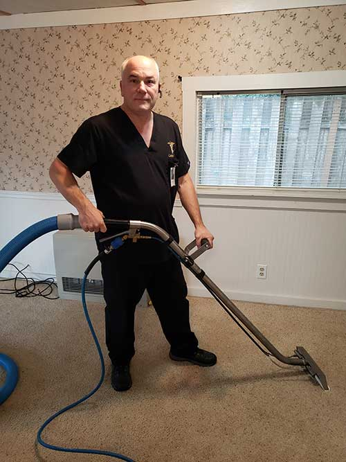 Owner Chris Sutton Cleaning Carpet In Banks Oregon